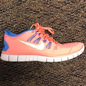Nike pink and green free runs
